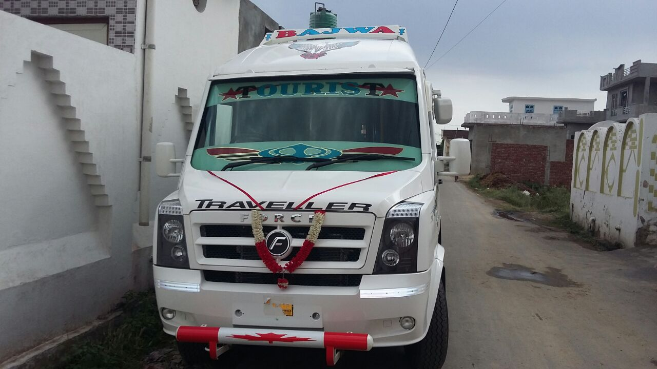 9 seater Tempo Traveller in Chandigarh